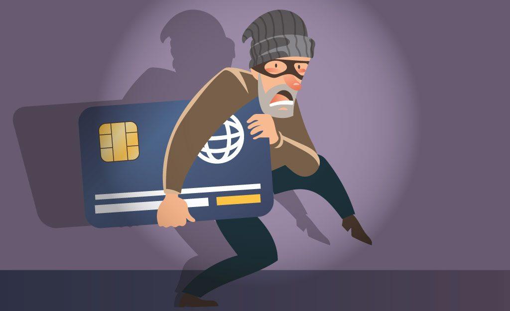 Bild på hacker som tar kreditkortsinformation